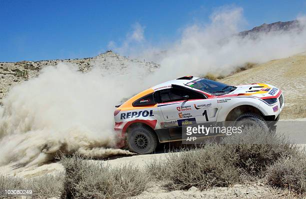 Spain's Nani Roma competes in his Mitsubihi during the 3rd stage of the Baja Aragon 2010 near of Zaragoza north of spain on July 25 2010 AFP PHOTO /...