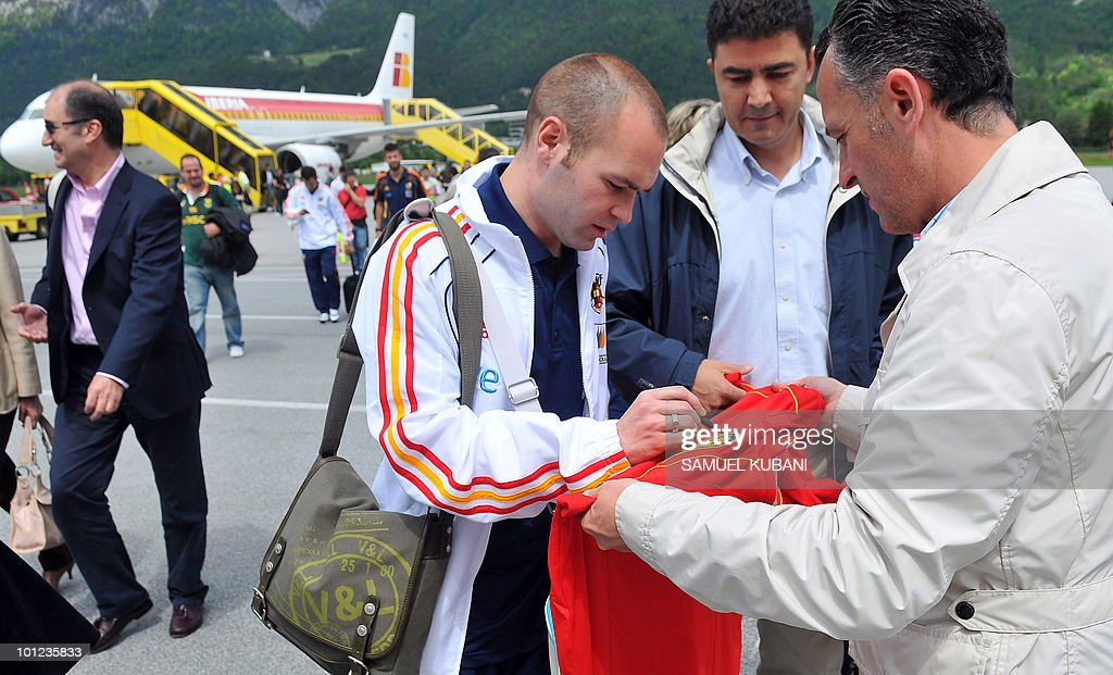 Spain's national football player Andres Iniesta (3rd R) signs an autograph on the team's arrival at Innsbruck airport on May 28, 2010, ahead of their training camp in Austria before of the World Cup 2010 in South Africa. European champions Spain have one of the most complete sides in world football and an in-depth squad packed full of talent, but a spate of injuries to key players is disrupting their preparations for this summer's World Cup assault.