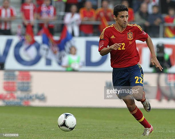 Spain's national football team player Jesus Navas runs with the ball during the friendly football match between Spain and Serbia at the AFG Arena in...