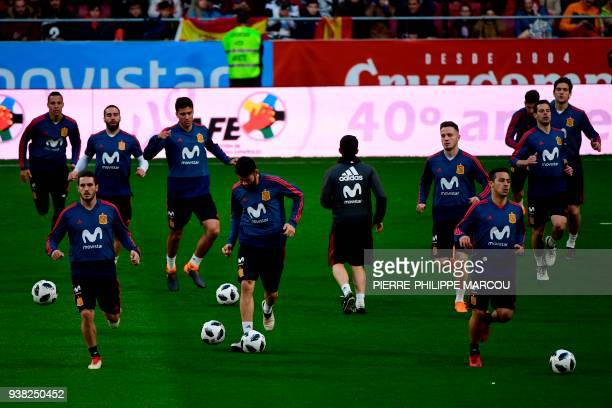 Spain's national football team players take part in a training session at the Wanda Metropolitano Stadium in Madrid on March 26 2018 on the eve of an...