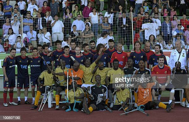 Spain's national football team pose with Sierra Leone's war amputees football players before a training session of the Spanish football team on May...