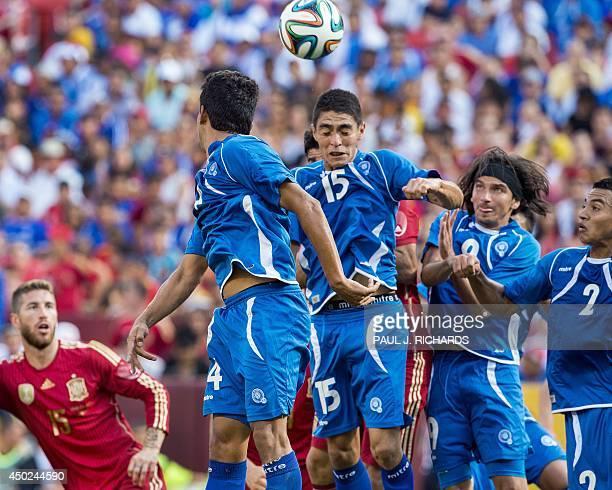 Spains National Soccer team Defender Sergio Ramos watches as El Salvador National Soccer team members Johathan Barrios Raul Renderos Rafael Burgos...