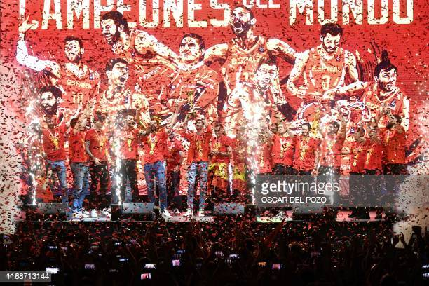 TOPSHOT Spain's national team players pose with the trophy on stage on Colon Square in Madrid on September 16 as they celebrate their victory in the...