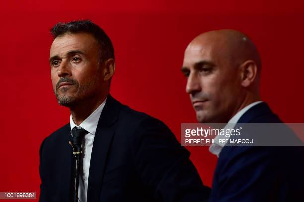 Spain's new coach Luis Enrique talks to the press next to Spanish football federation president Luis Rubiales during his during his official...
