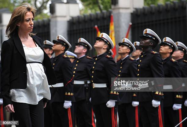 Spain's new Defence Minister Carme Chacon reviews a contingent of troops in a ceremony at the defence ministry after being sworn into office earlier...