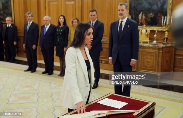 Spain's new Minister for equality Irene Montero takes the oath of office during a ceremony next to Spanish King Felipe VI at the Zarzuela Palace in...