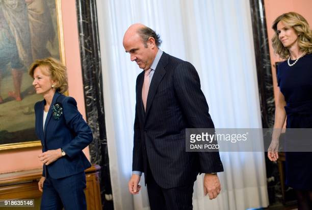 Spain's new Minister of Economy and Competitiveness Luis de Guindos former Science Minister Elena Garmendia and former Economy Minister Elena Salgado...