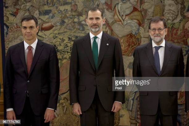 Spain's new Prime Minister Pedro Sanchez King Felipe VI of Spain and Former Prime Minister Mariano Rajoy pose during the swearing ceremony at the...