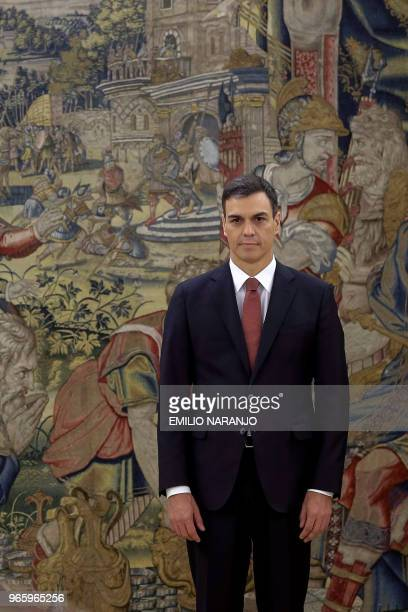 Spain's new Prime Minister Pedro Sanchez poses during a swearingin ceremony at the Zarzuela Palace near Madrid on June 2 2018 Spain's Socialist chief...