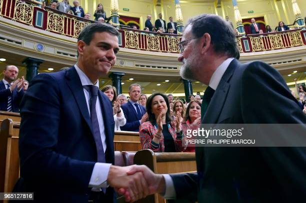Spain's new Prime Minister Pedro Sanchez shakes hands with Spain's outgoing Prime Minister Mariano Rajoy after a vote on a noconfidence motion at the...