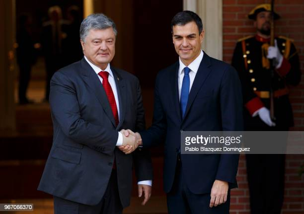 Spain's new Prime Minister Pedro Sanchez shakes hands with the President of Ukraine Petro Poroshenko as they pose for the press at Moncloa Palace on...