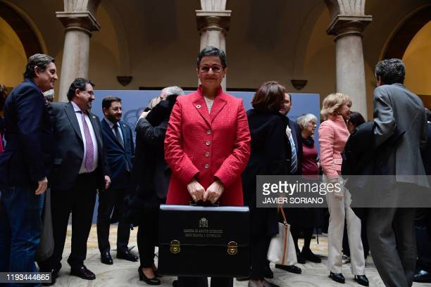 Spain's newly appointed Foreign Minister Arancha Gonzalez Laya poses with her new briefcase during a ceremony in Madrid on January 13 2020 Spain's...