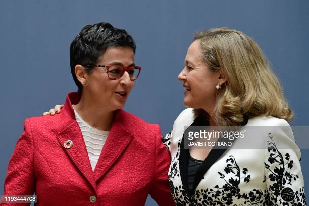 Spain's newly appointed Foreign Minister Arancha Gonzalez Laya talks to Spain's Deputy Prime Minister for economic affairs Nadia Calvino during a...