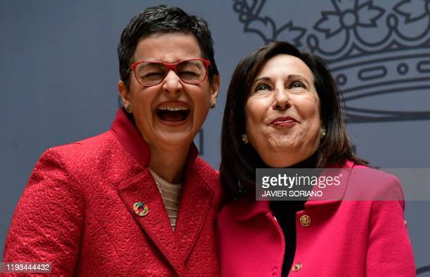 Spain's newly appointed Spain's Foreign Minister Arancha Gonzalez Laya poses with Spain's newly appointed Defence Minister Margarita Robles during a...