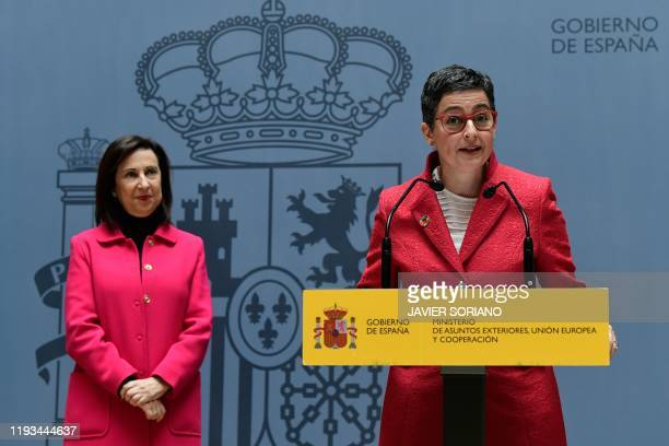 Spain's newly appointed Spain's Foreign Minister Arancha Gonzalez Laya gives a speech next to Spain's Foreign Minister and newly appointed Defence...
