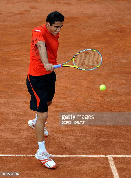 Spain's Nicolas Almagro plays a return during his men's quarter-final against compatriot Rafael Nadal in the French Open tennis championship at the...
