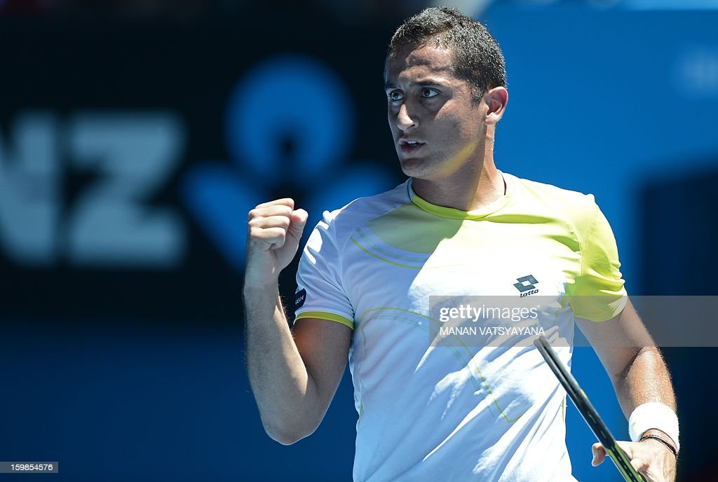 Spain's Nicolas Almagro reacts after a point against Spain's David Ferrer during their men's singles match on day nine of the Australian Open tennis tournament in Melbourne on January 22, 2013.