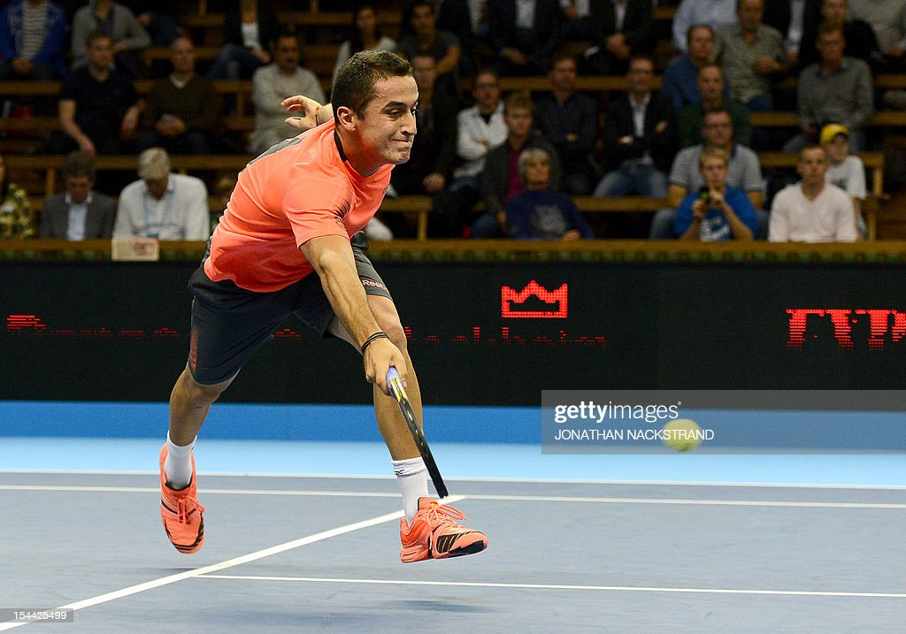 Spain's Nicolas Almagro returns the ball to Australia's Lleyton Hewitt during the quarter-finals at the ATP Stockholm Open tennis tournament on October 19, 2012 in Stockholm