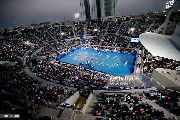 Spain's Nicolas Almagro serves to Serbia's Novak Djokovic during their Mubadala World Tennis Championship final match in the Emirati capital Abu...
