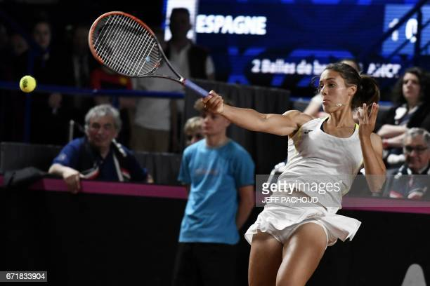 Spain's Olga Saez Larra hits a return to France's pair Alize Cornet and Amandine Hesse during the Fed Cup tennis match between France and Spain in...