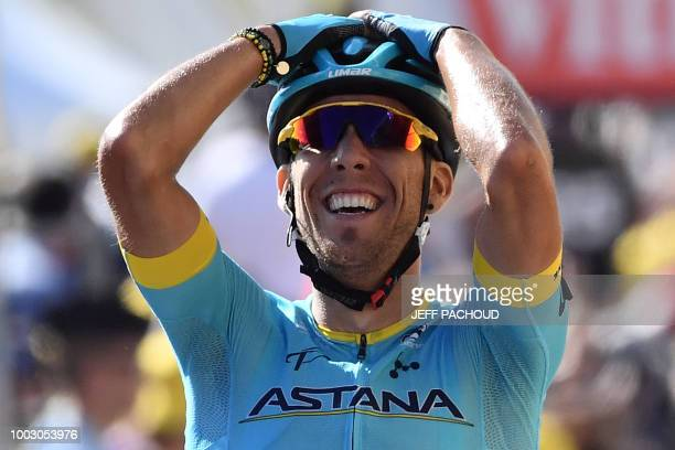Spain's Omar Fraile celebrates a she crosses the finish line to win the 14th stage of the 105th edition of the Tour de France cycling race between...