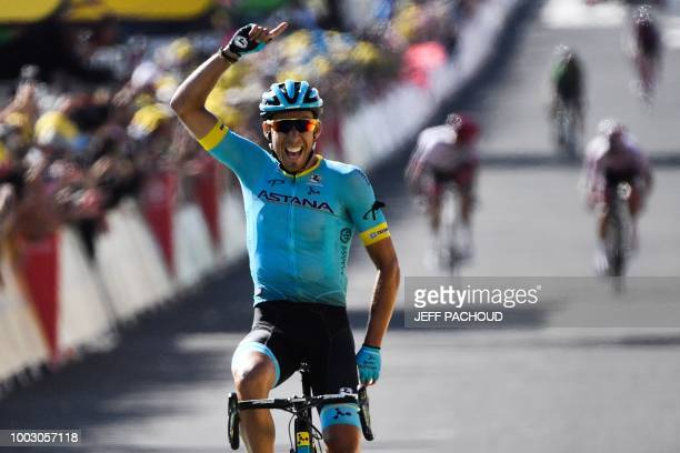TOPSHOT Spain's Omar Fraile celebrates a she crosses the finish line to win the 14th stage of the 105th edition of the Tour de France cycling race...
