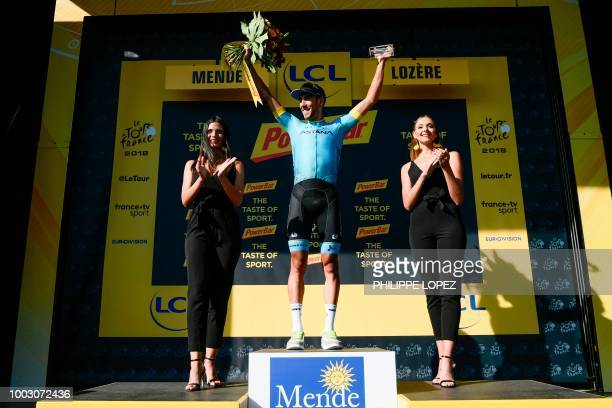 Spain's Omar Fraile celebrates on the podium after winning the 14th stage of the 105th edition of the Tour de France cycling race between...