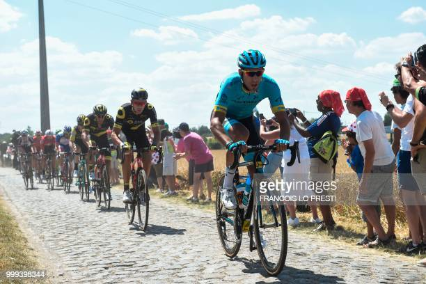Spain's Omar Fraile rides through the stage's first cobblestone section during a ninemen breakaway in Thunl'Eveque during the ninth stage of the...