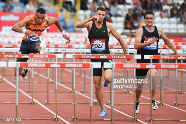 Spain's Orlando Ortega clears a hurdle ahead of Britain's Andrew Pozzi and Canada's Johnathan Cabral on his way to winning the men's 110m hurdles...