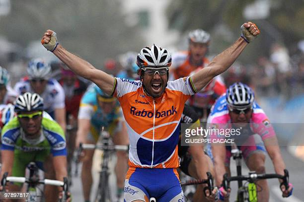 Spain's Oscar Freire crosses the finish line of the 101st Milan SanRemo spring classic in victory on March 20 2010 in San Remo The 34yearold Spaniard...