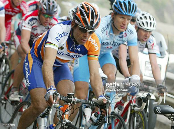 Spain's Oscar Gomez Freire rides during the 95th edition of MilanSan Remo cycling race 20 March 2004 Freire won the race while Germany's Erik Zabel...