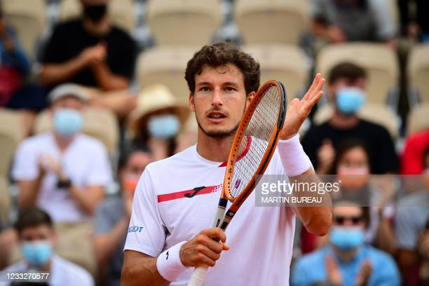 Spain's Pablo Carreno Busta celebrates after winning against Steve Johnson of the US during their men's singles third round tennis match on Day 6 of...