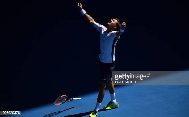 Spain's Pablo Carreno Busta celebrates his victory during the men's singles third round match against Luxembourg's Gilles Muller on day five of the...