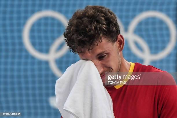 Spain's Pablo Carreno Busta reacts after defeating Serbia's Novak Djokovic during their Tokyo 2020 Olympic Games men's singles tennis match for the...