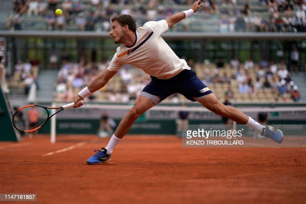 TOPSHOT Spain's Pablo Carreno Busta returns the ball to France's Benoit Paire during their men's singles third round match on day six of The Roland...