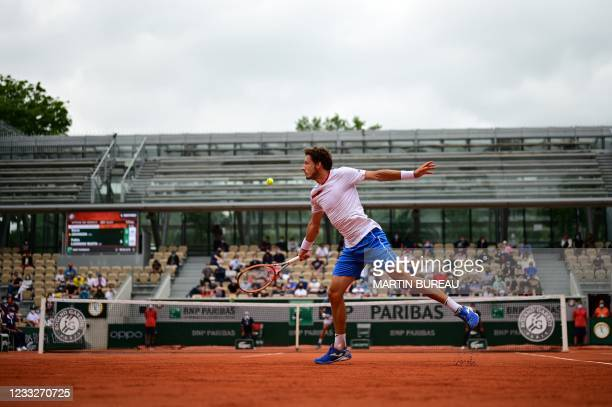 Spain's Pablo Carreno Busta returns the ball to Steve Johnson of the US during their men's singles third round tennis match on Day 6 of The Roland...