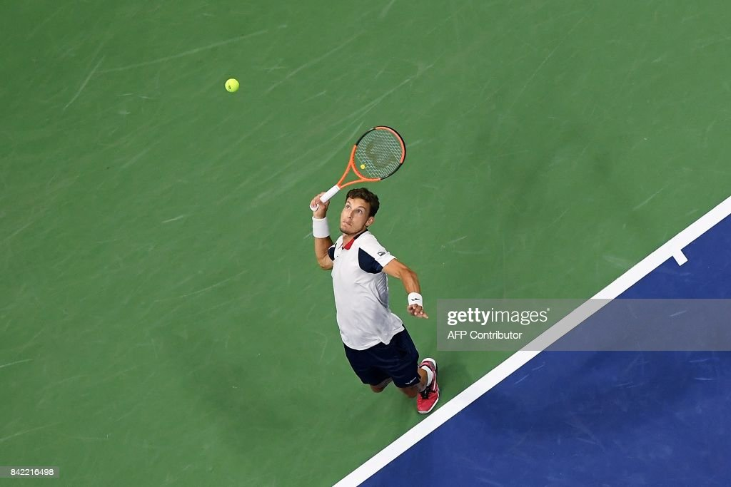 Spain's Pablo Carreno Busta serves the ball to Canada's Denis Shapovalov during their qualifying 2017 US Open Men's Singles match at the USTA Billie Jean King National Tennis Center in New York on September 3, 2017. / AFP PHOTO / Jewel SAMAD