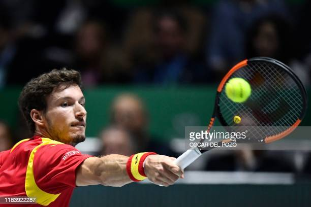 Spain's Pablo Carreno returns the ball to Argentina's Guido Pella during the singles quarter-final tennis match between Argentina and Spain at the...