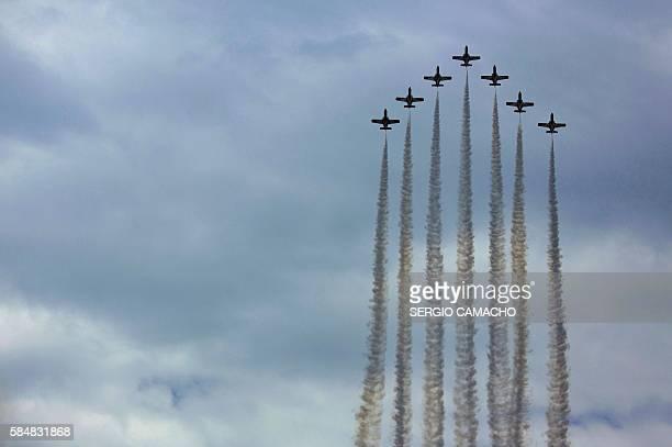 Spain's patrulla aguila or Eagle patrol perform aerobatics during the Torre del Mar International Air Festival in Torre del Mar near Malaga on July...