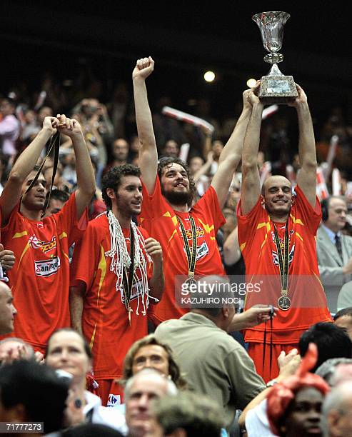 Spain's Pau Gasol and his teammates celebrate their victory over Greece after the final of the World Basketball Championship in Saitama 03 September...