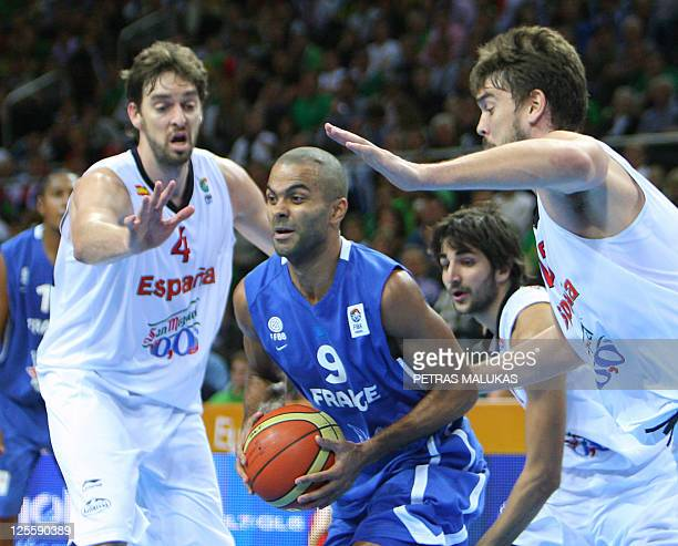 Spain's Pau Gasol and Marc Gasol vie with France's Tony Parker during the Eurobasket 2011 final basketball match Spain against France in Kaunas on...