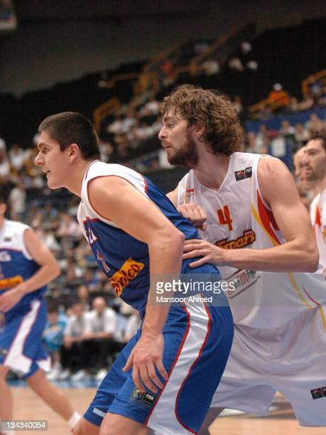 Spain's Pau Gasol background and Serebia's Darko Milicic foreground battle for position during the FIBA World Championship 2006 Final Eight at the...