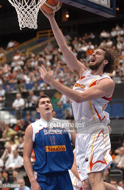 Spain's Pau Gasol manages to get past Darko Milicic of Serbia during the FIBA World Championship 2006 Final Eight at the Saitama Super Arena Tokyo...