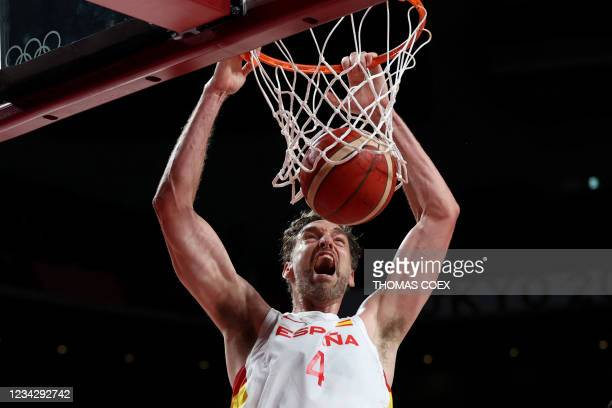 Spain's Pau Gasol Saez dunks the ball in the men's preliminary round group C basketball match between Spain and Argentina during the Tokyo 2020...