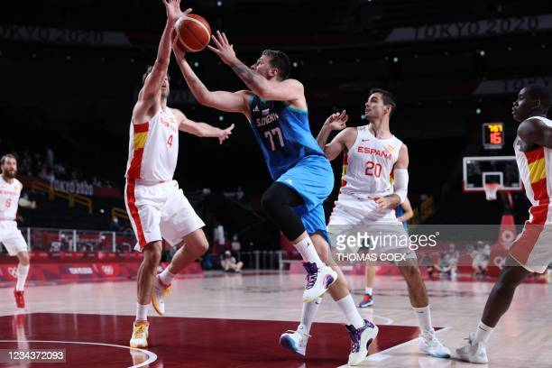 Spain's Pau Gasol Saez fights for the ball with Slovenia's Luka Doncic in the men's preliminary round group C basketball match between Spain and...