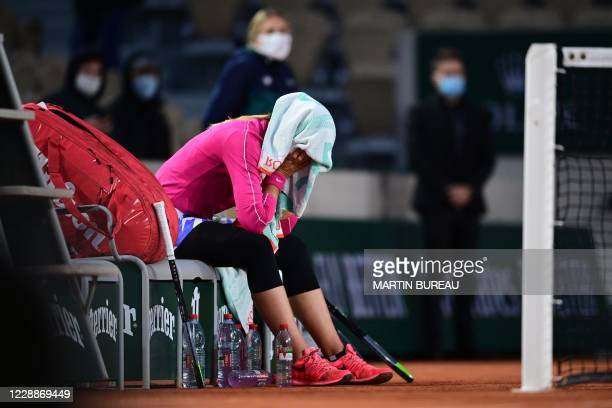 Spain's Paula Badosa reacts after winning against Latvia's Jelena Ostapenko at the end of their women's singles third round tennis match on Day 7 of...