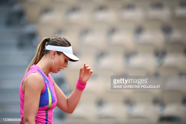 Spain's Paula Badosa reacts as she plays against Germany's Laura Siegemund during their women's singles fourth round tennis match on Day 9 of The...