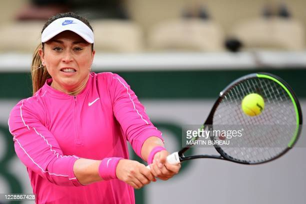 Spain's Paula Badosa returns the ball to Latvia's Jelena Ostapenko during their women's singles third round tennis match on Day 7 of The Roland...