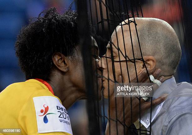 Spain's player Alexandrina Barbosa is welcomed by her husband's kiss to celebrate their victory over Denmark in Fonix Hall of Debrecen on December 17...