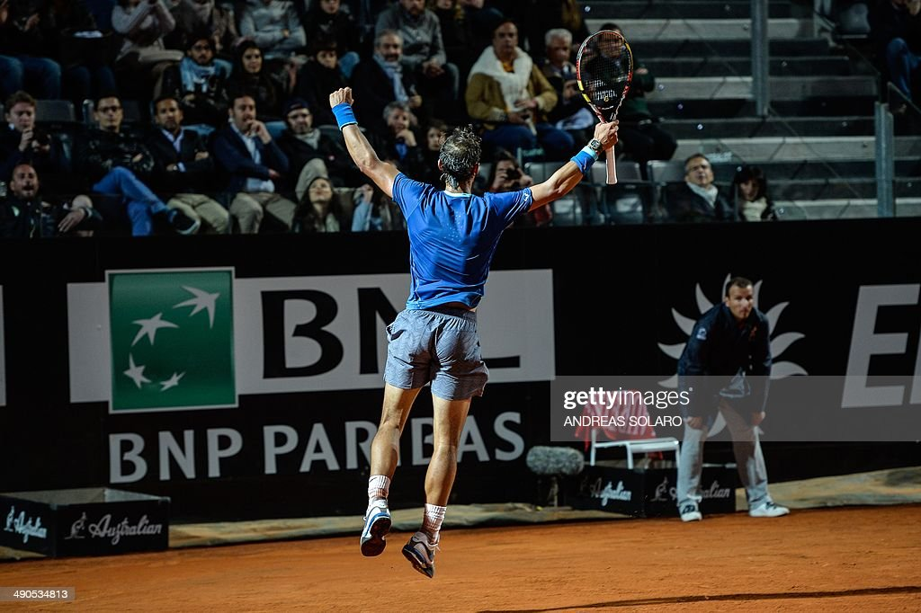 Spain's player Rafael Nadal celebrates after defeating France's Gilles Simon during a Rome Masters Tennis match on May 14, 2014, at the Foro Italico in Rome.